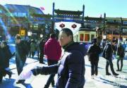 前门现黑导游揽客 180元包游北京众景点